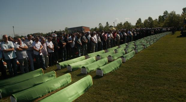 Relatives and friends of the victims gathered at a football stadium in Kozarac near the town of Prijedor (Almir Alic/AP)