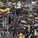 Protesters take part in a march in Hong Kong (Vincent Yu/AP)