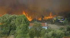 Emergency services try to extinguish wildfires in Vila de Rei, Portugal (TVI via AP)