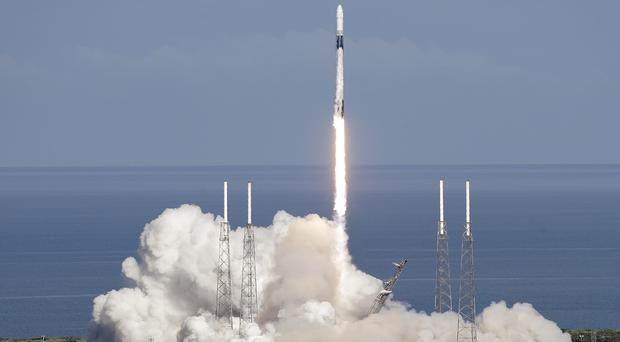 A Falcon 9 SpaceX rocket takes off at Cape Canaveral (John Raoux/AP)