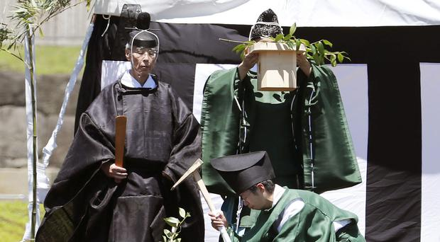 Shinto priests attend a groundbreaking ceremony at the Imperial Palace in Tokyo (Kyodo/AP)
