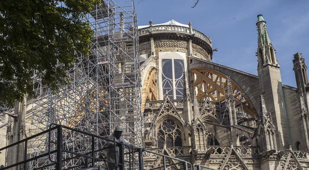 Scaffolding is erected during preliminary work to repair the fire damage at Notre-Dame de Paris Cathedral (Rafael Yaghobzadeh/AP)