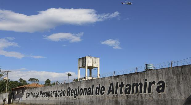 A police helicopter flies over the Regional Recovery Center, a prison, in Altamira, Para state, Brazil, Monday, July 29, 2019. Authorities say at least 52 prisoners were killed by other inmates during a riot, and that some of the victims were decapitated while others asphyxiated. (Wilson Soares/Panamazonica/AP)