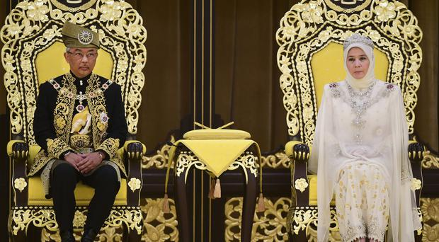 Malaysia's King Sultan Abdullah Sultan Ahmad Shah and Queen Tunku Azizah attend the royal coronation (Malaysia Information Ministry/AP)