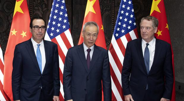 Chinese Vice Premier Liu He, center, poses with US Trade Representative Robert Lighthizer, right, and Treasury Secretary Steven Mnuchin (AP/Ng Han Guan, Pool)