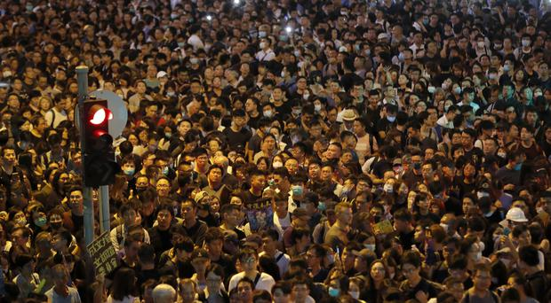Protesters gather at a demonstration by civil servants in Hong Kong (AP)