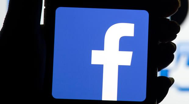 Facebook has confirmed it is working on launching a 'news tab' for its service this autumn (Dominic Lipinski/PA)