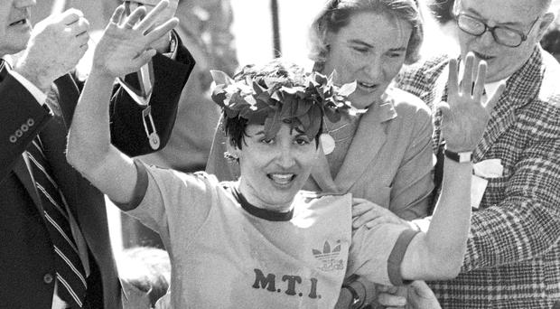 Rosie Ruiz waves to the crowd after after being announced as winner of the women's division of the Boston Marathon (AP File)