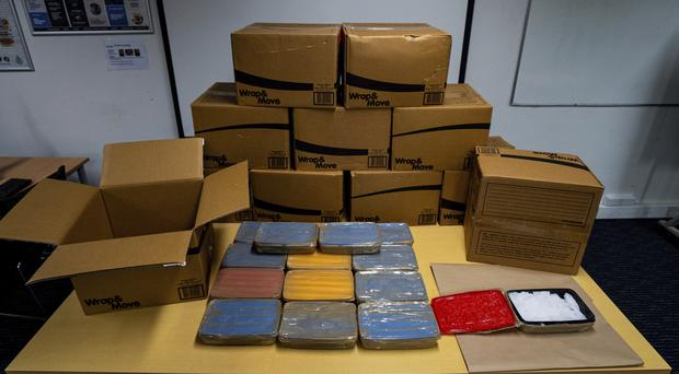 Boxes containing methamphetamine are displayed by the police in Auckland (New Zealand Police/AP)
