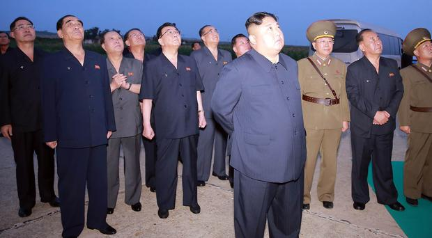North Korean leader Kim Jong Un, centre, has reportedly supervised a weapons demonstration (Korean Central News Agency/AP)