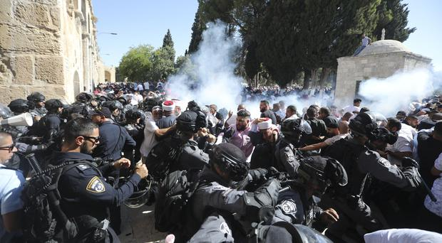 Israeli police clash with Palestinian worshippers at al-Aqsa mosque compound in Jerusalem (Mahmoud Illean/AP)