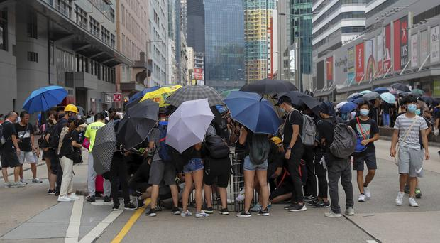 Protesters gather in Hong Kong (Kin Cheung/AP)