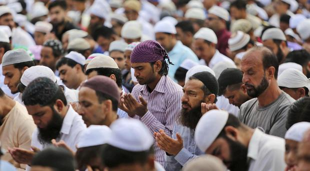 Muslim men offer prayers during Eid al-Adha, or the Feast of the Sacrifice, in Jammu, India (Channi Anand/AP)