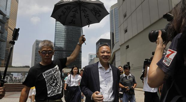 Benny Tai leaves High Court in Hong Kong (Vincent Yu/AP)