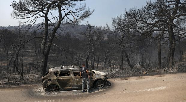 Damage caused in the village of Makrymalli after the fire raged through (Yorgos Karahalis/AP)