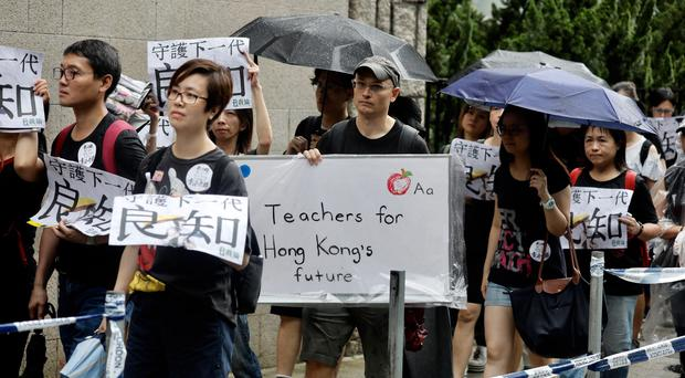 Pro-democracy protesters march in Hong Kong (Vincent Yu/AP)