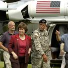 President Bush, right, accompanied by Louisiana governor Kathleen Blanco, arrives in Baton Rouge, Louisiana, for a briefing at the state Office of Emergency Preparedness, following the devastation caused by Hurricane Katrina (Patrick Dennis/AP)
