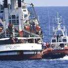 An Italian Coast Guard boat approaches the Spanish humanitarian rescue ship Open Arms (Salvatore Cavalli/AP)
