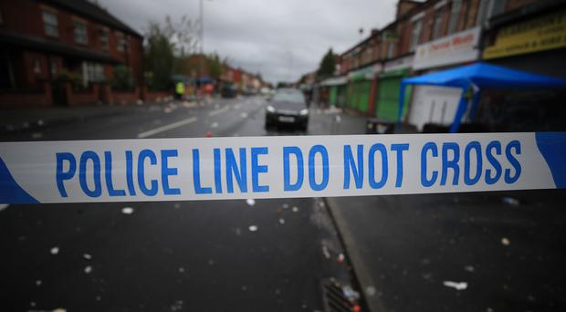 General photo of police tape (Peter Byrne/PA)