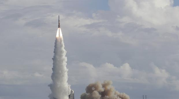 A United Launch Alliance Delta IV rocket lifts off at the Cape Canaveral Air Force Station (John Raoux/AP)