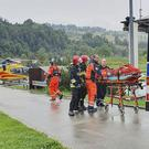 A rescue helicopter and ambulance in Poland's southern Tatra Mountains after a sudden thunderstorm (Bartlomiej Jurecki/AP)