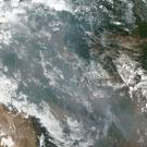 A satellite image shows the fires in Brazil (Nasa/AP)