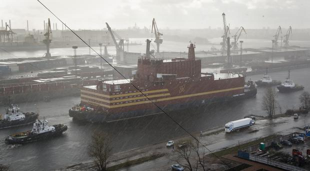 The floating nuclear power plant, the Akademik Lomonosov, is towed out of the St Petersburg shipyard (Dmitri Lovetsky/AP)