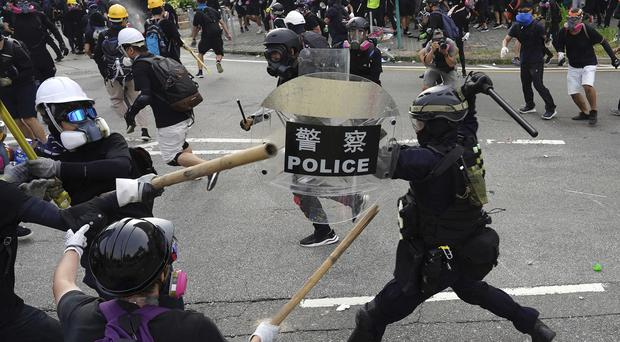 Police and demonstrators clash in Hong Kong (AP)
