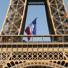 Firefighters unfurled a huge French flag from the Eiffel Tower (Michel Spingler/AP)