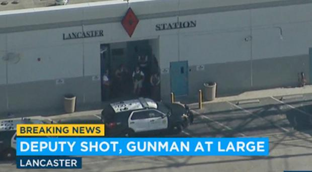 Screengrab of police at the sheriff's station in Lancaster ((KABC-TV via AP)