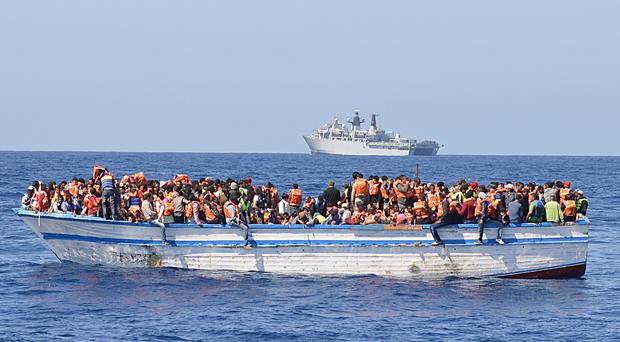 File picture of migrants in the Mediterranean Sea (Louise George/MoD/Crown Copyright)
