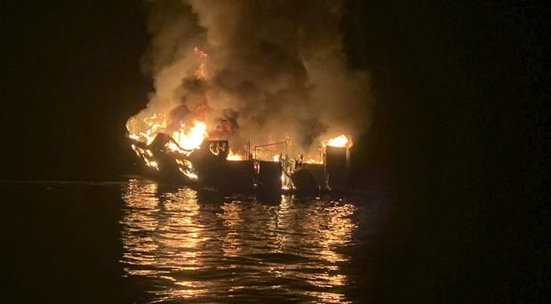 A boat is engulfed in flames after a deadly fire broke out aboard the commercial scuba diving vessel off the Southern California coast (Santa Barbara County Fire Department via AP)