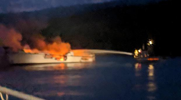 Firefighters work to extinguish a dive boat engulfed in flames (Santa Barbara Fire Department/AP)