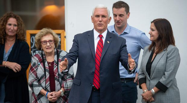 US Vice President Mike Pence (centre), arrives in Doonbeg, Co Clare, where he stayed in a hotel owned by Donald Trump (Jacob King/PA)