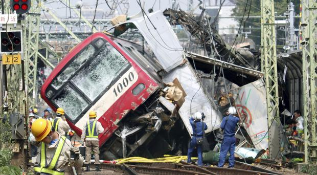 A train sits derailed (Kyodo News via AP)
