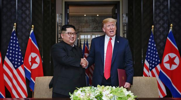 President Donald Trump and leader of North Korea, Kim Jong-un, at Capella, Singapore (Kevin Lim/Straits Times/AP)
