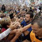 Leader of The League party, Matteo Salvini, is cheered by supporters at a party's rally in Pontida (Luca Bruno/AP)