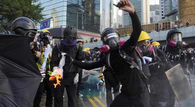 An anti-government protester throws a Molotov cocktail during a demonstration near Central Government Complex in Hong Kong (Vincent Yu/AP)