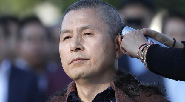 Hwang Kyo-ahn, the main opposition Liberty Korea Party chairman, has his head shaved in Seou (Lee Jin-man/AP)