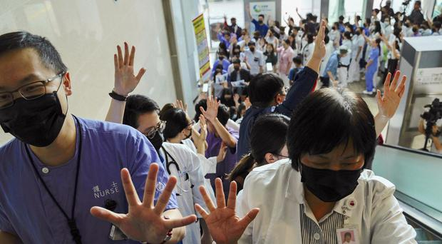Medical workers at the Prince of Wales Hospital in Hong Kong (Vincent Yu/AP)