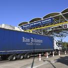 A lorry on its way to France waits to be checked by employees of Eurotunnel in Folkestone (Denis Charlet, Pool via AP)