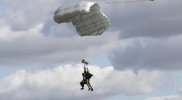 Tom Rice approaches the landing zone in a tandem parachute jump (Peter Dejong/AP)