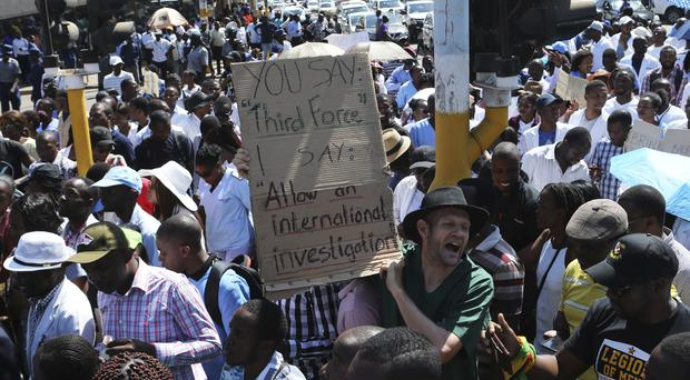 Zimbabewean medical staff march on the streets of Harare (AP Photo/Tsvangirayi Mukwazhi)