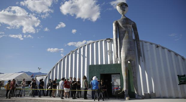 People line up outside of the gift shop at the Storm Area 51 Basecamp event (AP/John Locher)