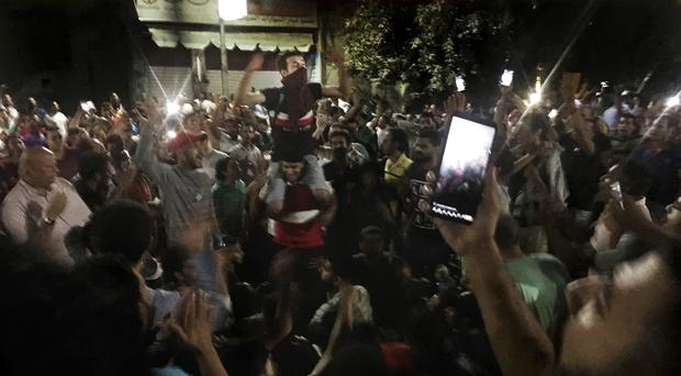 Dozens of people held a rare protest in Cairo (AP Photo/Nariman El-Mofty)