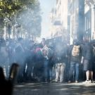 Demonstrators take cover from tear gas (AP/Kamil Zihnioglu)