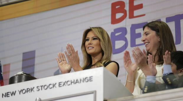 Melania Trump, with the help of students from the United Nations International School, ring the opening bell of the NYSE (Seth Wenig/AP)