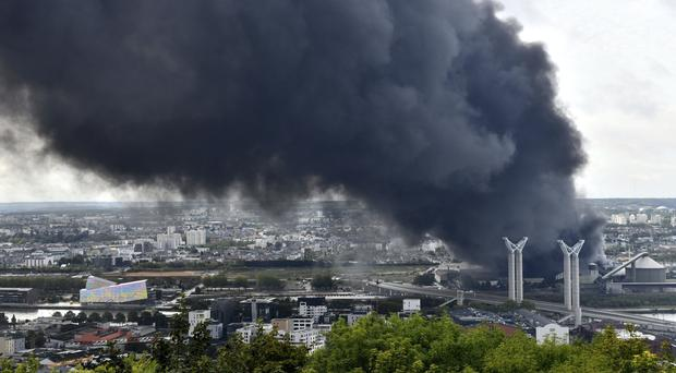 Black smoke after a fire at a chemical plant in Rouen, Normandy (Stephanie Peron/AP)