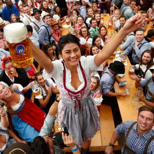 A young woman celebrates the opening of the 185th Oktoberfest (Matthias Schrader/AP)