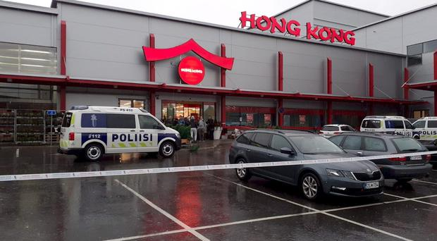 Police attend the scene of a violent incident at the Hermanni shopping centre in Kuopio, Finland, Tuesday Oct. 1, 2019. Finnish police say that a man with a knife has killed one person and wounded at least three others at a shopping center in central Finland. (Jaakko Vesterinen/Lehtikuva via AP)